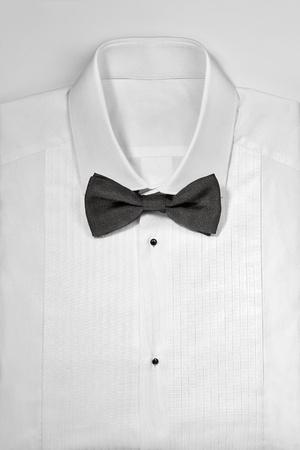 Luxury white tuxedo shirt and bowtie close up on white background Stock Photo - 14875166