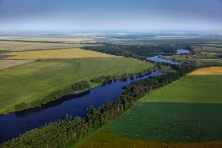 aerial view above the green fields and river Stock Photo