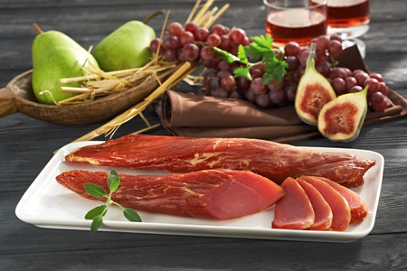 Delicious jerked meat with grapes and pears Stock Photo - 15563332