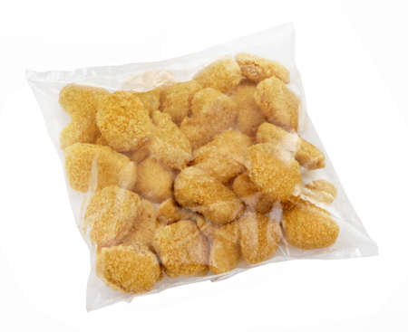 processed: Pack with ready-to-cook meat nuggets isolated on white background