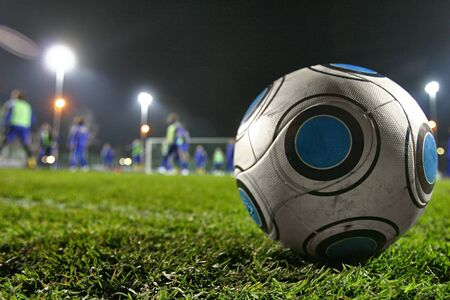 Silver-blue soccer ball on soccer field photo