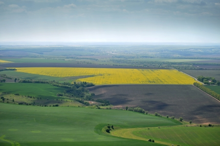 birds eye view of fields with farms and roads photo