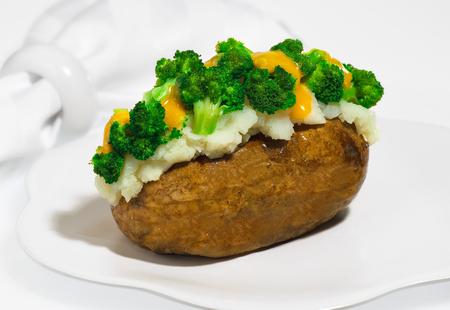 Baked stuffed potato with broccoli.