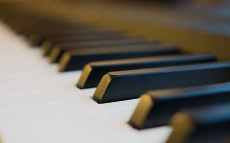 Piano keys with sepia effect and yellow lighting.