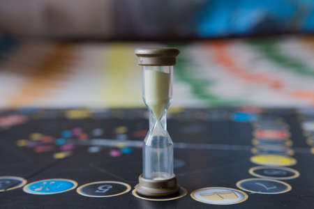 double cross: Hourglass on the playing field for board games. Stock Photo