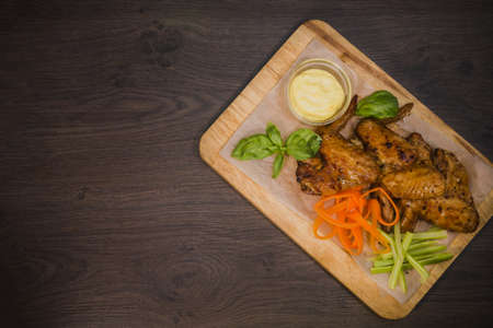 junk: Fried chicken wings with sauce and salad.