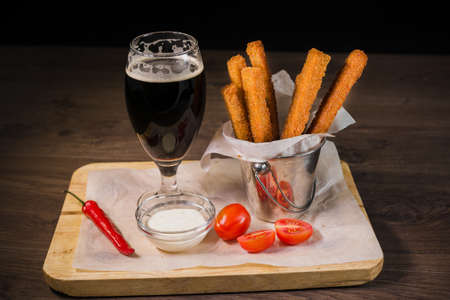 Snack for beer in the form of crackers and sauce for them. Zdjęcie Seryjne