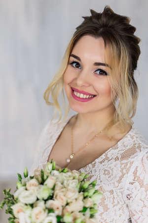 Beautiful woman in wedding dress in photo studio.