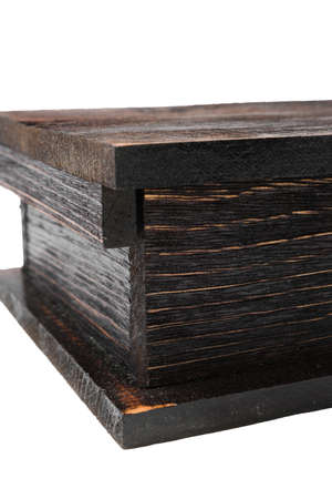 Wooden lacquered box on a white background