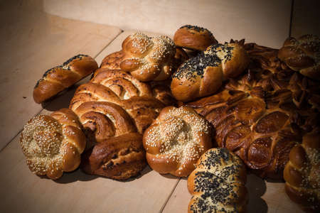 Different bakery products on a wooden background