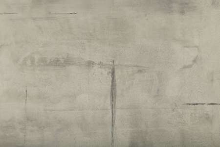 Raw or bare concrete wall, shot with panel seam lines perpendicular to image dimension