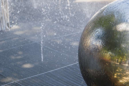 Chrome ball in the fountain, new design. 写真素材