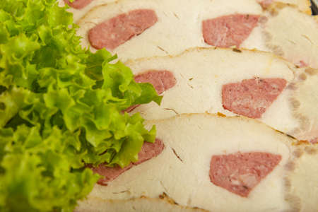 Meat sliced on a dish decorated with verdure