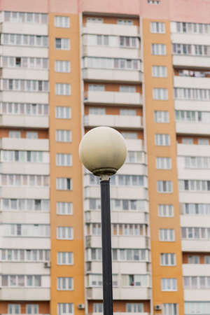 Street lamp on the background of a residential building. Imagens