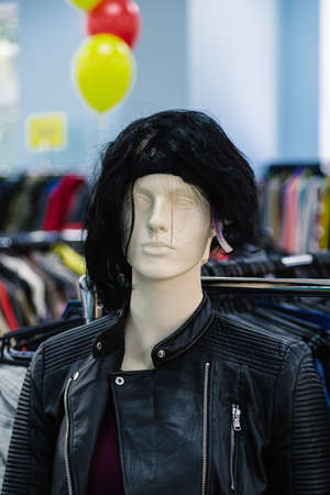 A mannequin dressed in fashionable stylish clothes in the store.