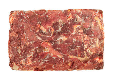 Frozen block of beef on a white background. Imagens