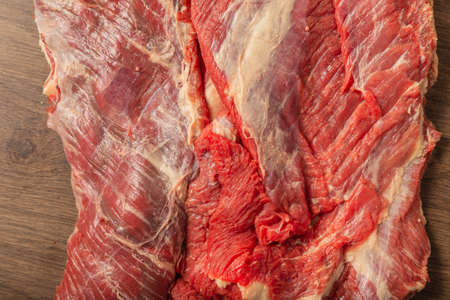 Raw fresh beef on a wooden background, catalog.