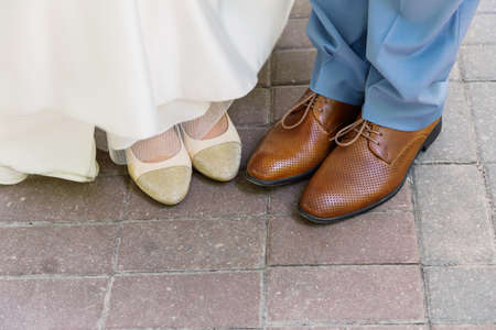 feet of the newlyweds. feet newlyweds marble floor. honeymoon shoes.
