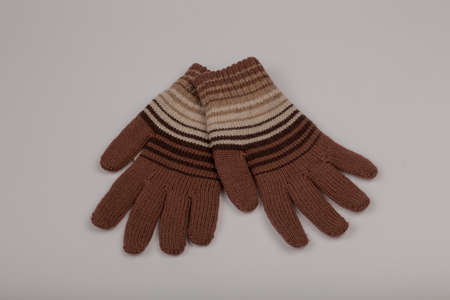 Children's winter gloves on a white background