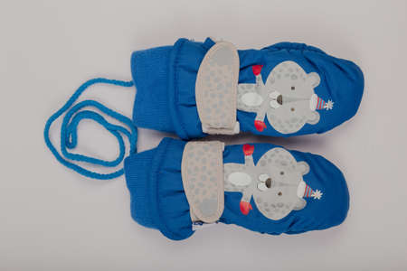 Childrens winter gloves on a white background Фото со стока