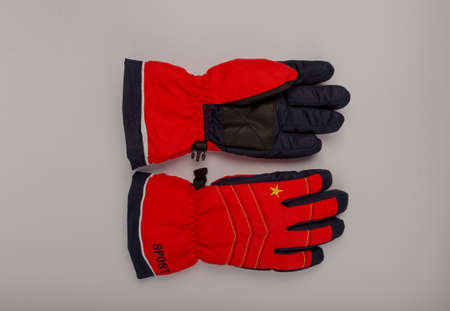 Childrens winter gloves on a white background Stock Photo