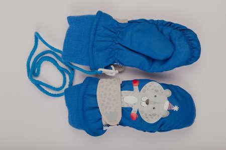 Childrens winter gloves on a white background.