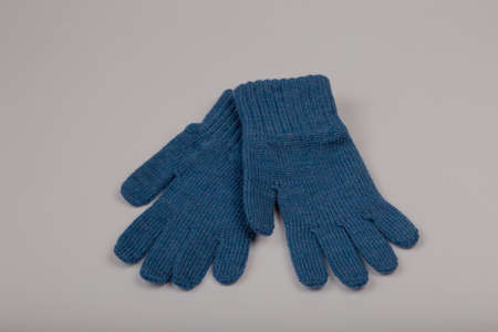 Childrens winter gloves on a white background.