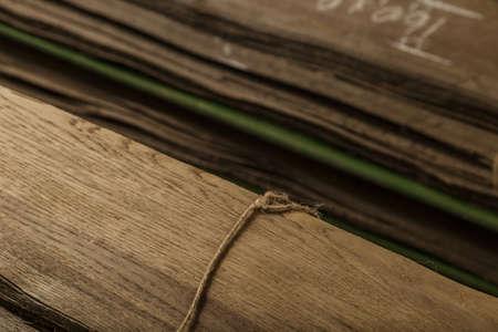 Veneered oak veneer folded into piles in the basement. 免版税图像