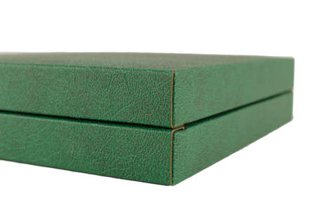 Green box of leather on a white background, isolate.