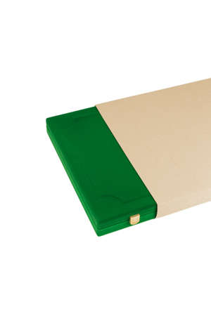 A box of green velvet in a cardboard box on a white background. Zdjęcie Seryjne