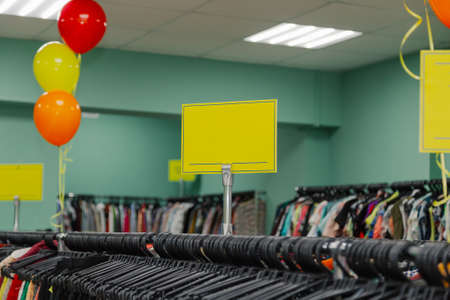 Colorful clothes on hangers in a store. Stockfoto - 130795115