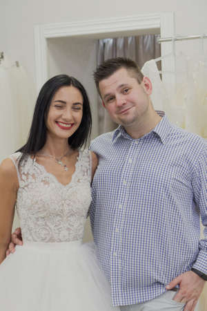 Beautiful man and woman in a wedding salon.