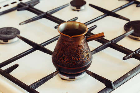 Turka with coffee on the gas stove. Stockfoto