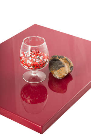 Natural stone and a glass on the varnished coating, the reflection of objects. 写真素材