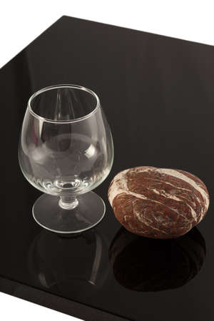Natural stone and a glass on the varnished coating, the reflection of objects 写真素材
