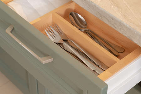 Shelf with cutlery in the kitchen with a new design. 스톡 콘텐츠