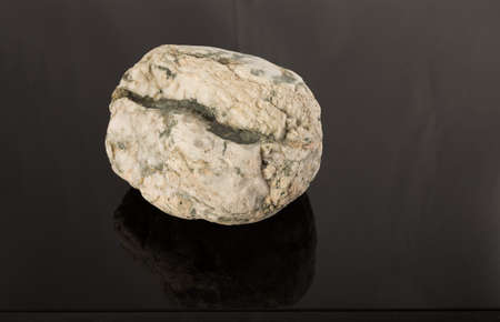 Natural stone on lacquered coating, reflection of objects.