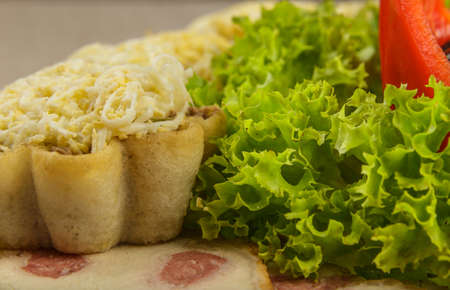 Tartlets with salad on a plate with greens Stock fotó