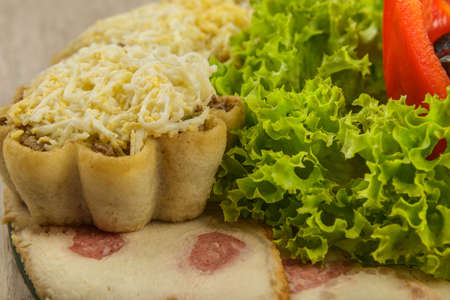 Tartlets with salad on a plate with greens. Stock fotó