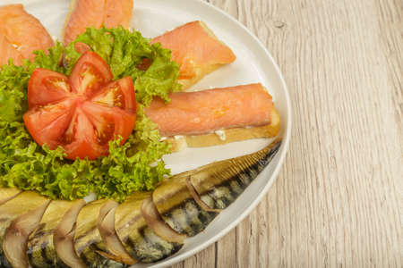 Sliced herring on a plate with herbs Reklamní fotografie
