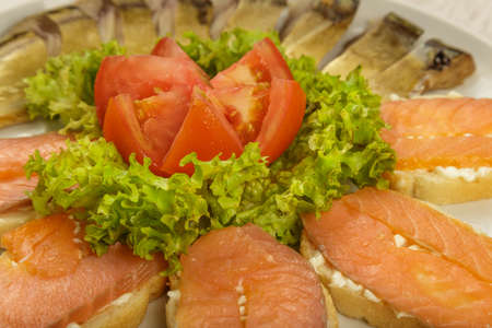 Sliced herring on a plate with herbs.