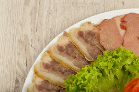Sausage cuts of different varieties on a plate.