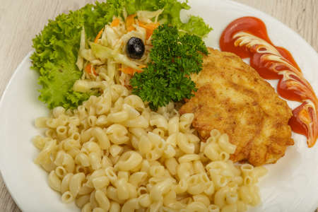 Pasta with a piece of grilled meat and salad 版權商用圖片