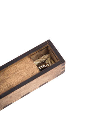 Beautiful wooden box with ballpoint pen inside on a white background.