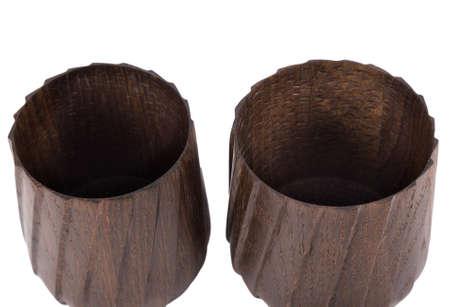 Elegant handmade wooden mugs on a white background.