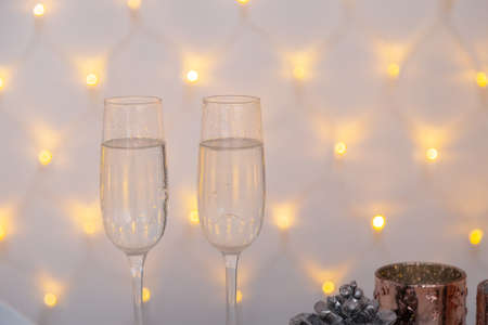 New Years glasses with champagne on a beautiful background. New Year 2020. Imagens