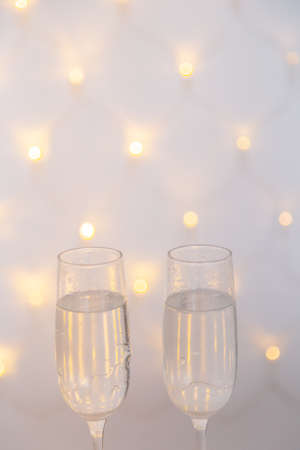 New Years glasses with champagne on a beautiful background. New Year 2020