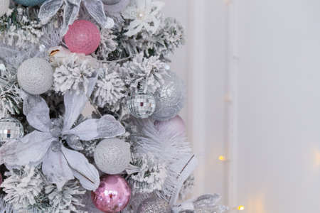 Beautiful silver Christmas tree with decorations. New Year 2020 Imagens