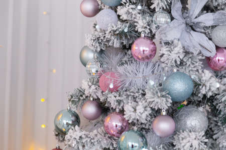 Beautiful silver Christmas tree with decorations. New Year 2020. Imagens