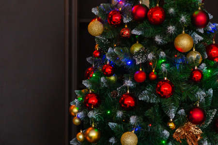 Beautiful green christmas tree with decorations. New Year 2020. Imagens